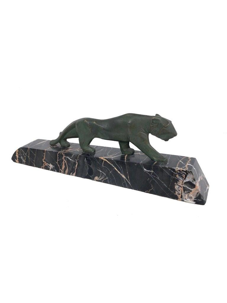 Walking lion Bronze sculpture on marble base Original Art Deco, France, 1930s   Dimensions:  Width 30 cm Height 10 cm Depth 5 cm.