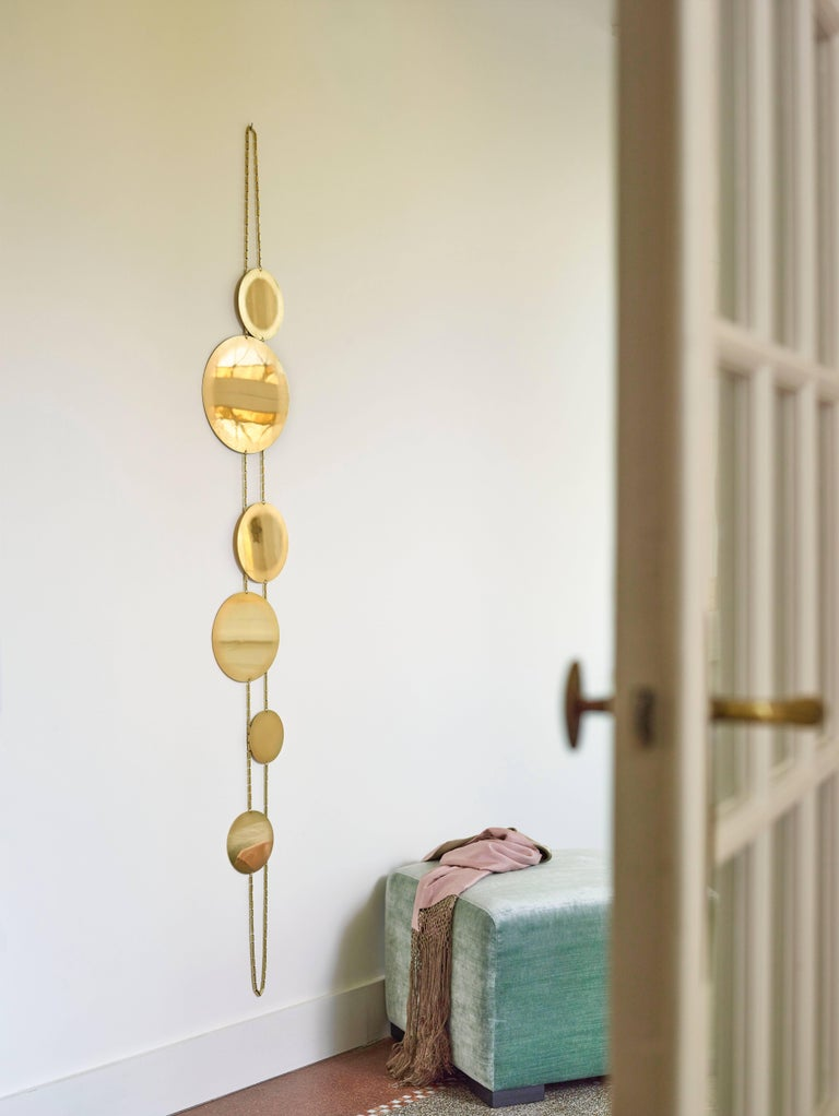 This decorative 'O' Mirror is inspired by a large-scale necklace or Sautoir. Each disk is mirror polished and sanded on the border. It is assembled with a brass chain.