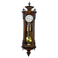Wall Clock from the Late 19th Century in Brown Wooden Case