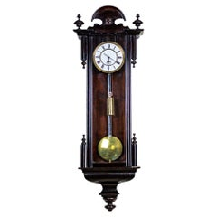 Wall Clock from the Late 19th Century in Black Glazed Wooden Case