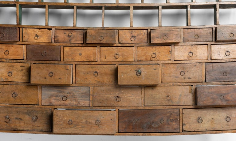 Painted fruitwood drawers with open shelving above.