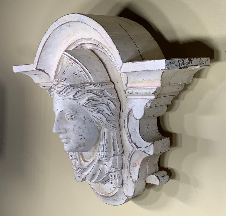 Beautiful hand carved wood sculpture of Minerva, in Roman religion, the goddess of handicrafts, the professions, the arts, and, later, war; she was commonly identified with the Greek Athena. Some scholars believe that her cult was that of Athena