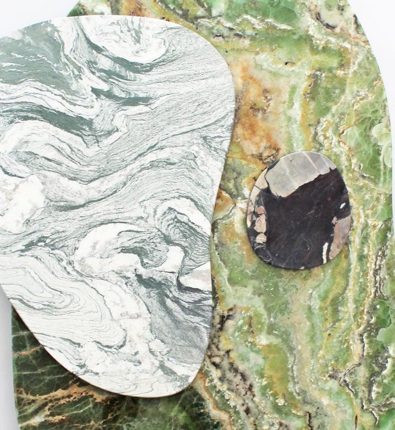 Wall lamp in marble - Sébastien Caporusso  Title: Eclipse  Material: Marble Onyx Vertura - St. Laurent verdé - Quatre saisons  Measures: H. 81 x L. 55 x D. 5 cm   To penetrate into the imagination of the interior architect and designer Sébastien