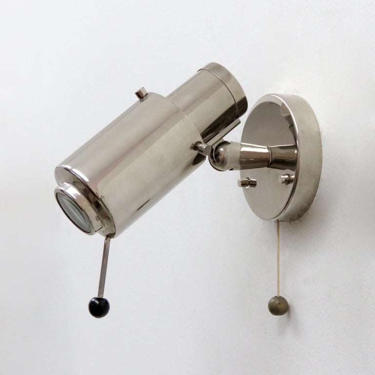 Pair of nickel-plated wall lights by Jacques Biny for Lita, magnifying lens, handle to adjust and on/off pull switch, marked.