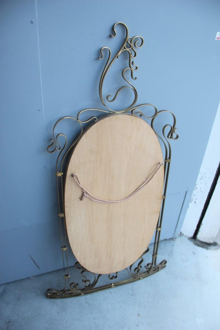 Mid-Century Modern Wall Mirror Made of Shaped Solid Brass and Hand-Worked French Design, 1950 For Sale