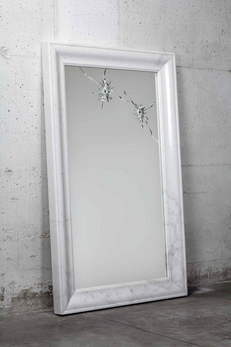 The seven years wall mirror is made of security-glass, mirror hit by gunshots and frame in polished statuary marble (origin: Tuscany). Mirror dimension: L 120 x W 75 cm. Each mirror is hand signed and numbered by the artists (engraved). 100%