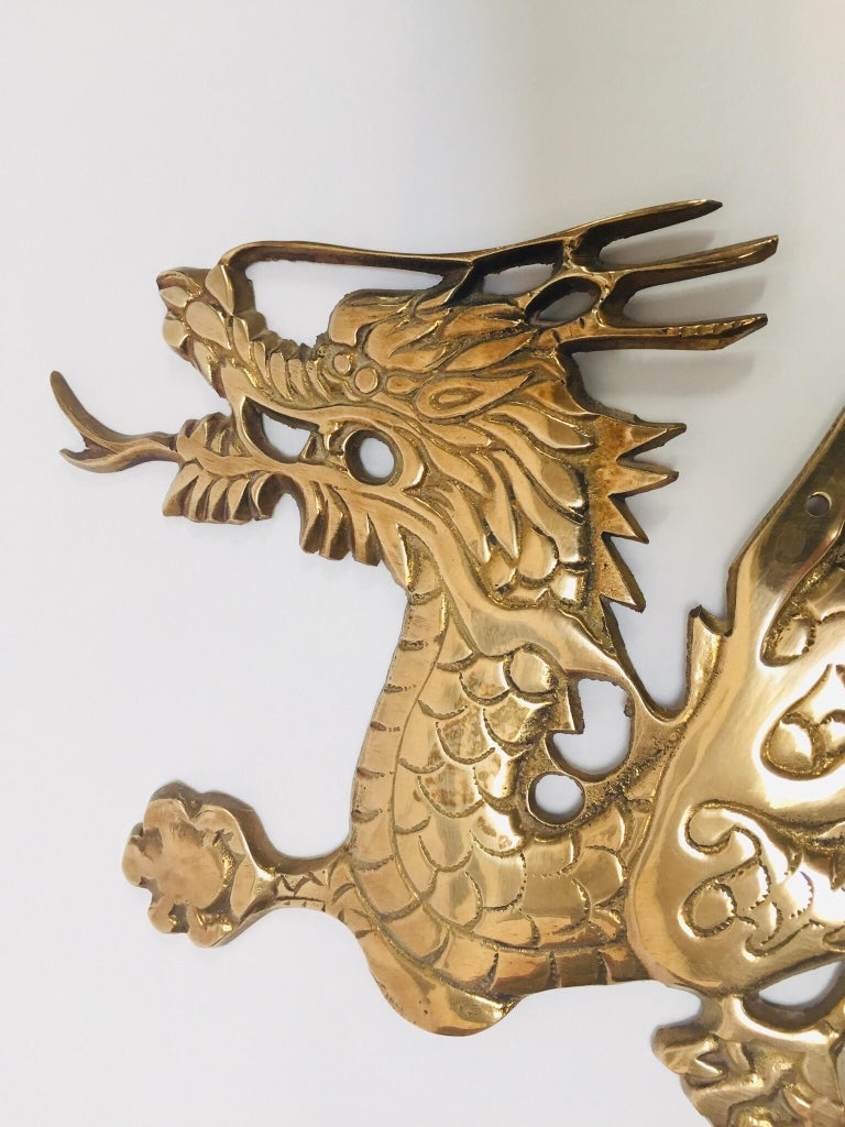 Wall mount, Asian cast brass dragon chasing a ball. Wall mount dragon chasing a ball is the auspicious scene of good luck, prosperity and wealth. It is believed that displaying dragon statue at home/office can attract auspicious energy. The ball