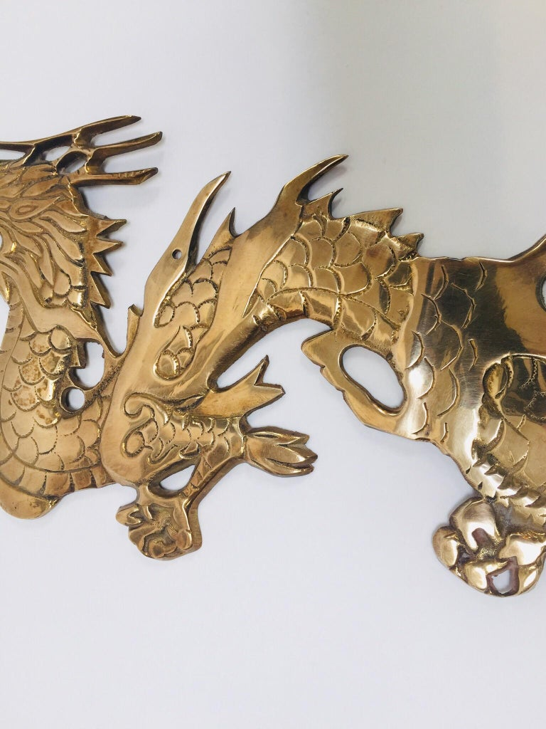 Chinoiserie Wall Mount, Asian Cast Brass Dragon Chasing a Ball For Sale