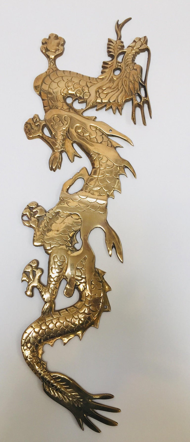 Hand-Carved Wall Mount, Asian Cast Brass Dragon Chasing a Ball For Sale