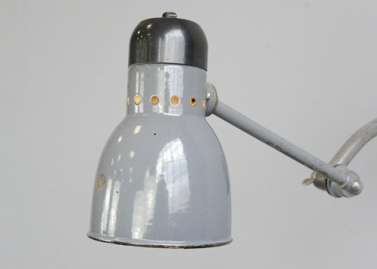 Wall-mounted task lamp by Kandem, circa 1930s  - Vitreous grey enamel shade - Bakelite switch and head - Branded Kandem on the Bakelite top - Takes E27 fitting bulbs - Made by Korting & Mathiesen - German, 1930s - Measures: 12cm wide -