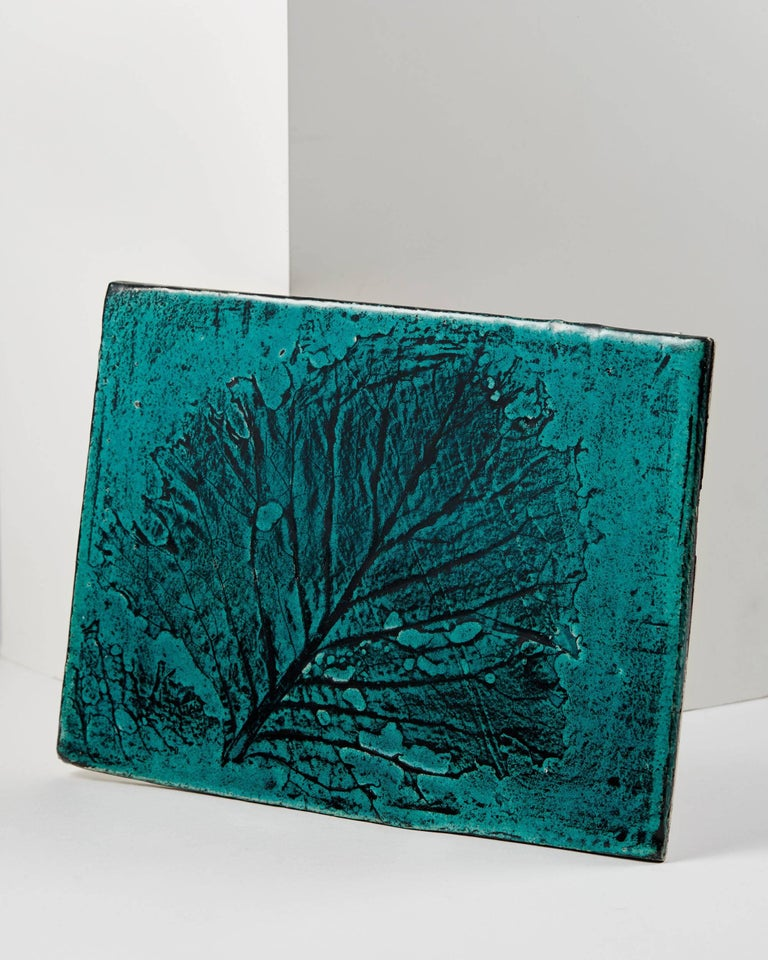 Wall plaque designed by Toini Muona for Arabia,  Finland, 1950s.  Measures: H 30 cm/ 12'' L 40 cm/ 15 3/4''.