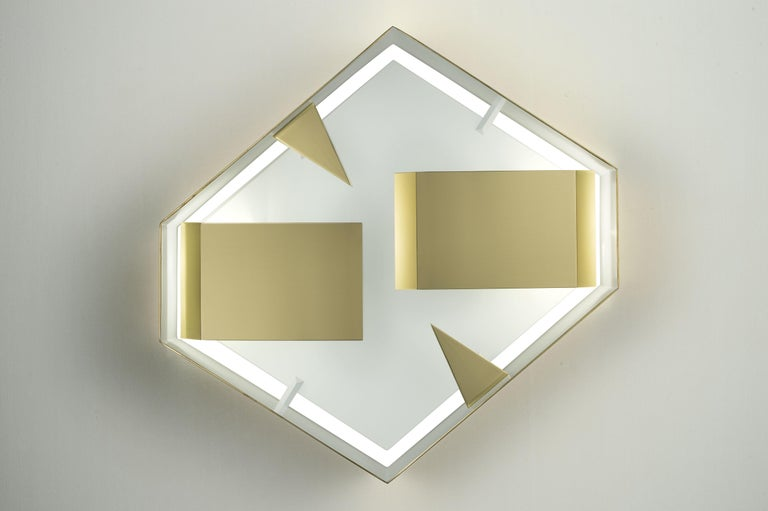 Wall sconce hexagonal 'Screen of Light' design by Gio Ponti Italy polished brass   Wall sculpture light in polished brass, timeless iconic design. Handcrafted product, realised by Pollice Illuminazione from the original drawings of Gio Ponti with