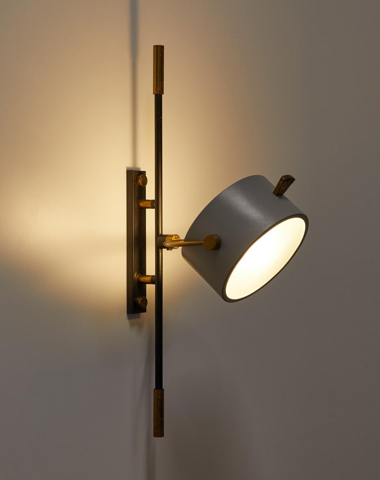 Mid-Century Modern Wall Sconce with Lens Shaped Reflector by Maison Lunel, France, 1950 For Sale