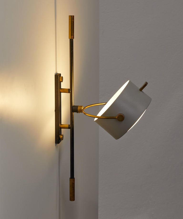 French Wall Sconce with Lens Shaped Reflector by Maison Lunel, France, 1950 For Sale