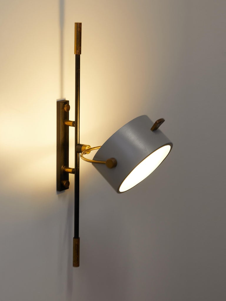 Wall Sconce with Lens Shaped Reflector by Maison Lunel, France, 1950 In Good Condition For Sale In Renens, CH