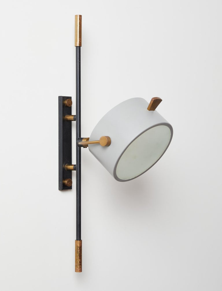 Mid-20th Century Wall Sconce with Lens Shaped Reflector by Maison Lunel, France, 1950 For Sale