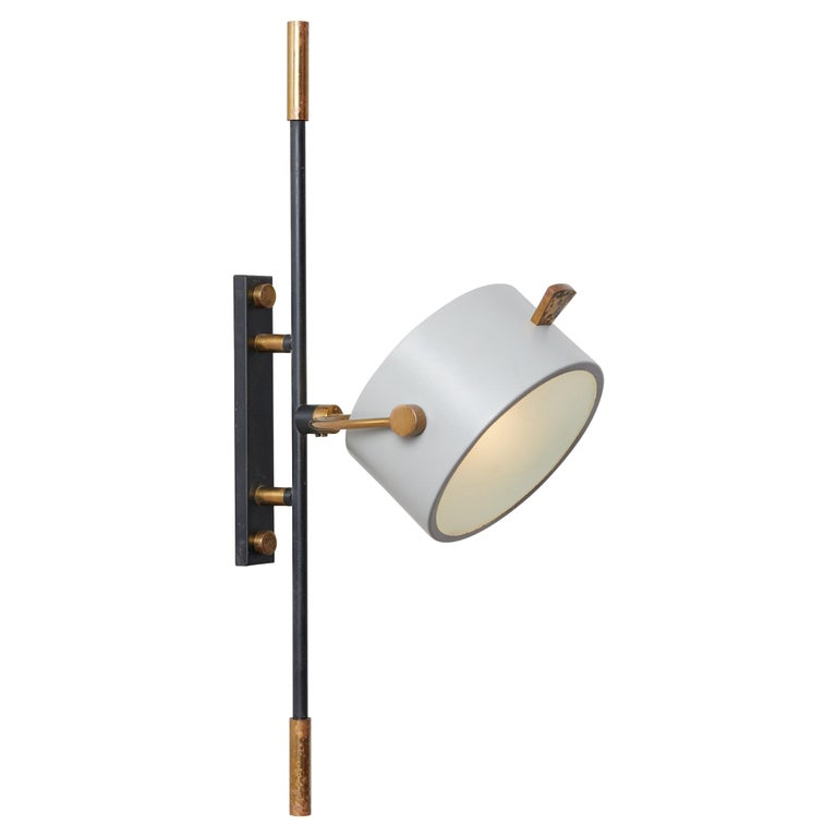 Wall Sconce with Lens Shaped Reflector by Maison Lunel, France, 1950 For Sale