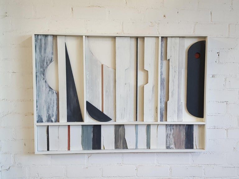 Architectural abstract frieze art wall panel by Paul Marra in wood, paint and gesso. Hand applied textured finish. Wood framing, subtle colors. Coloration will vary with daylight and light source. Materials are varied for purpose of organic, natural