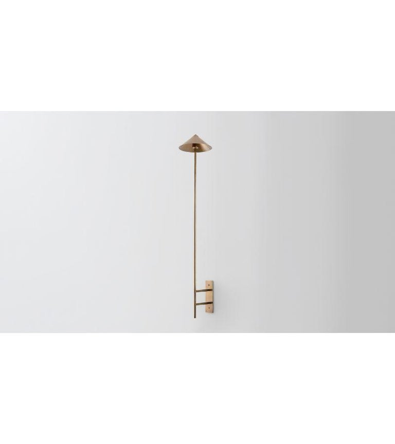 Wall stack down by Volker Haug Dimensions: D 21 x W 6 x H 40 cm  Material: Brass.  Finish: Polished, Aged, Brushed, Bronzed, Blackened, or Plated Light: 12V G4 LED x 3 Power supply: : 110V-240V, 12V transformer supplied Weight: approx 2.5