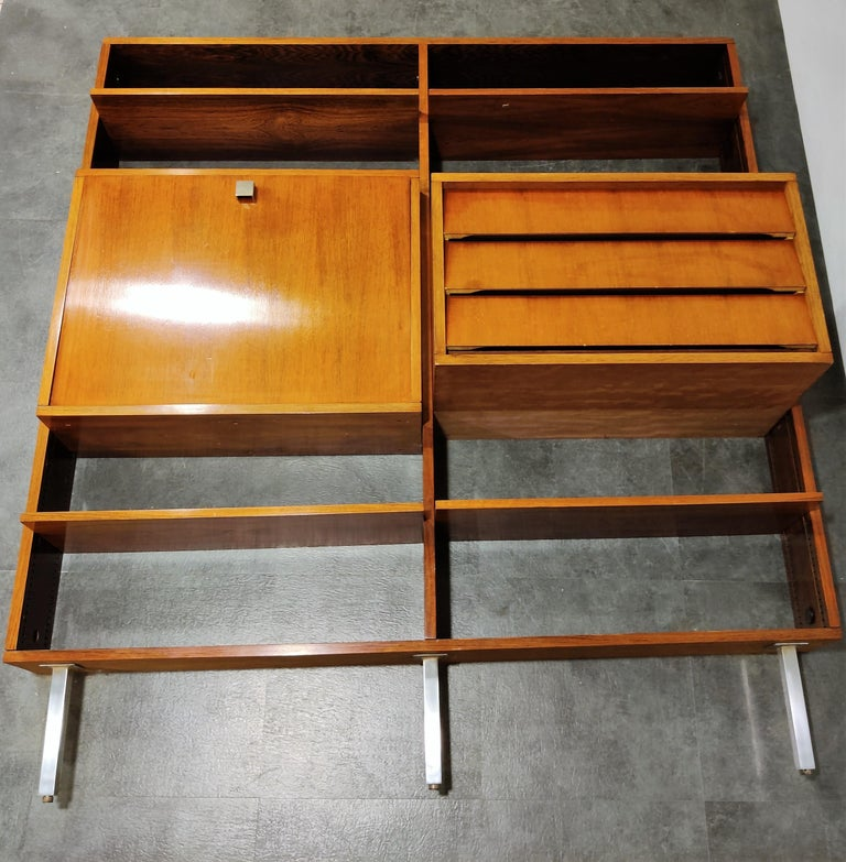 Mid century wall unit in rosewood designed by Alfred Hendrickx for Belform.  The wall unit is completely modular and consists of a bar compartment with light, 4 shelves and a cabinet with 3 drawers.  1960s - Belgium  Good overall