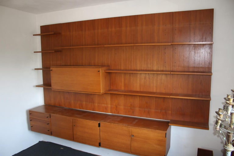 a wall unit from the 60s by the Designer Gúnter Renkel,  made by Rego Mobile from teak,  the wall unit consists of separate parts with 4 wall panels  2 wall panels are 50 cm wide  2 wall panels are 95 cm wide  all 4 wall panels are 150 cm