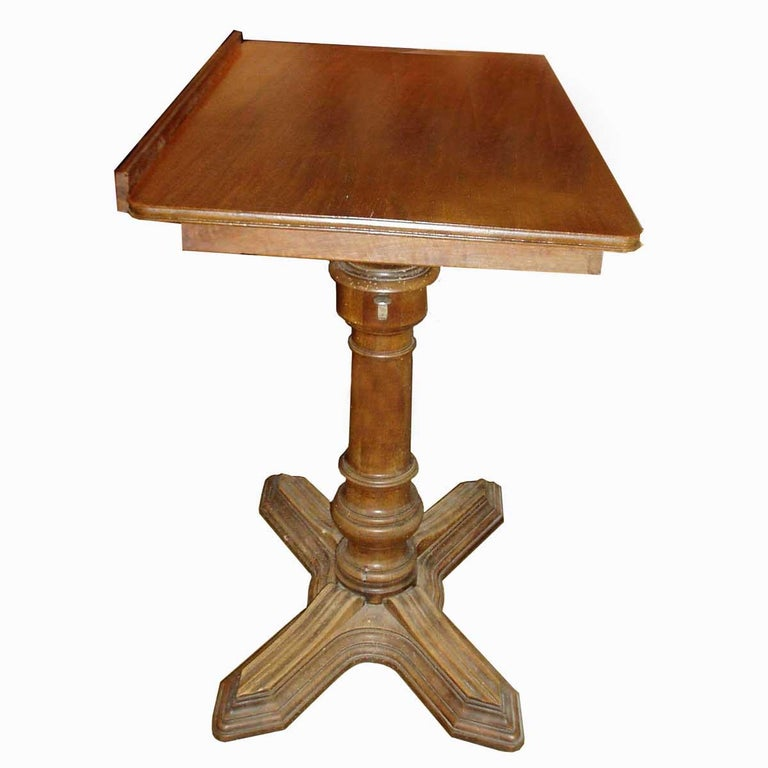 Conceived by E. Chouanard, one of the most respected French engineers and designers of the 19th century, this elegant and metamorphic table, dubbed Soleil and made entirely of walnut, can serve as a side table, a nightstand, or an easel, with