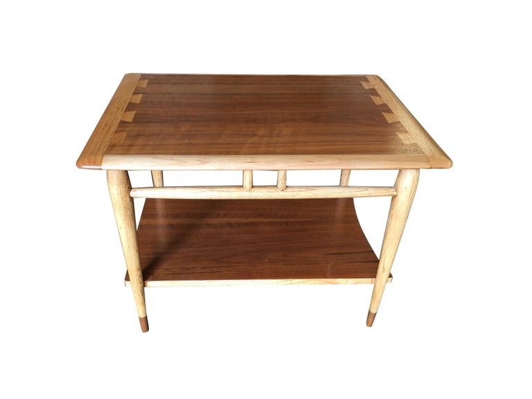 Mid-Century walnut two-tier side table with walnut and ash inlay designed by Andre Bus for Lane in 1958.