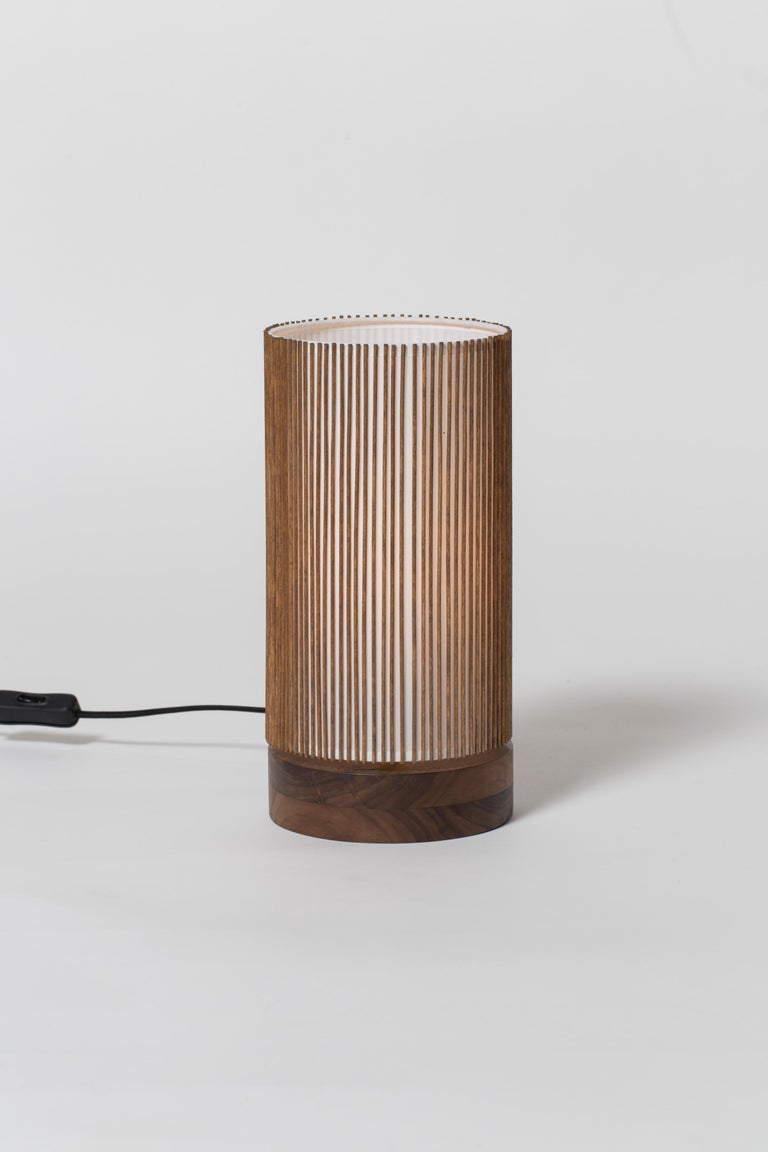 The bedside table lamp is part of the re-issued Smilow Lighting collection, originally designed by Mel Smilow in 1956 and officially reintroduced by his daughter Judy Smilow in 2017. This collection's sculptural and nature-inspired pieces bring a