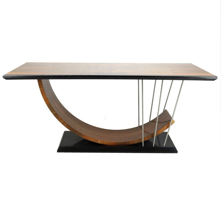 New dining table made of black mud oak wood, walnut weneer and stainless steel. Made to order.