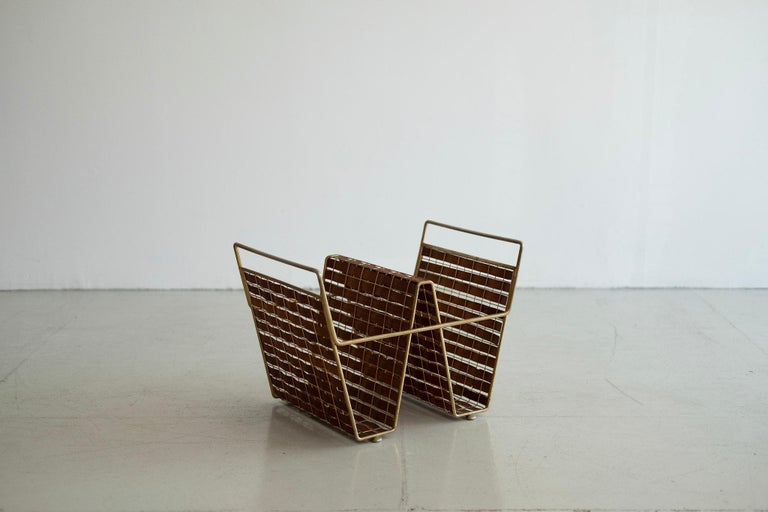 A collection of walnut woven wood and brass accessories that include magazine holders, plant holder, trash can. Priced individually.