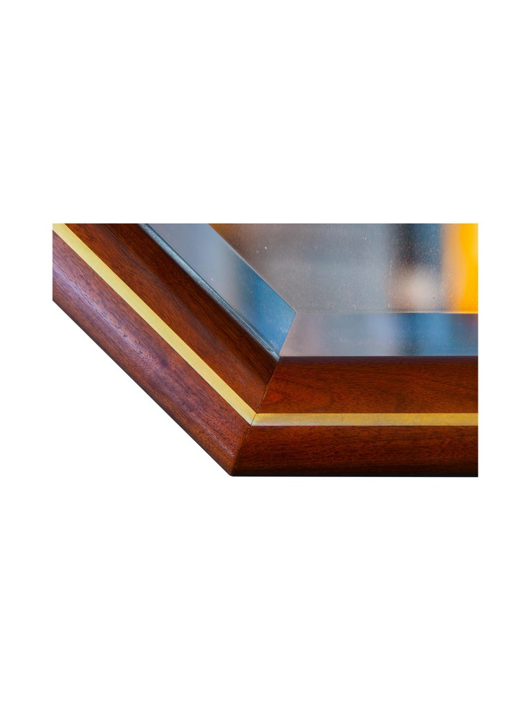 Mirror information  Walnut with brass inlay elongated octagon mirror  Walnut  Brass inlay  Measures: 60