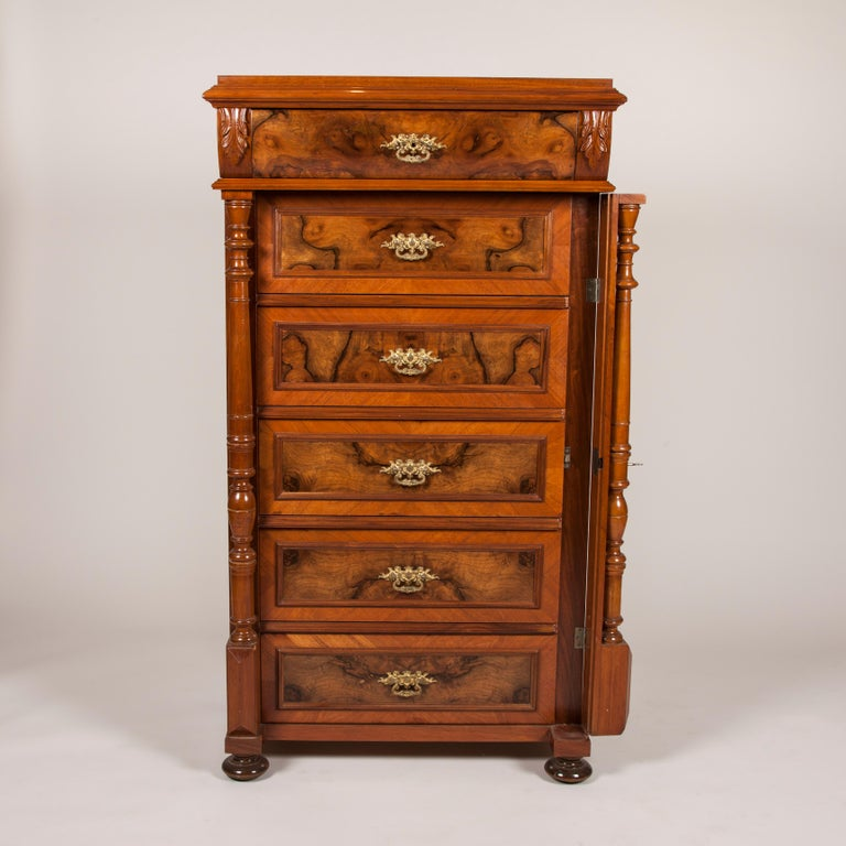 A walnut and burr walnut chest of drawers with ormolu mounts and locking pilaster, six graduating drawers.