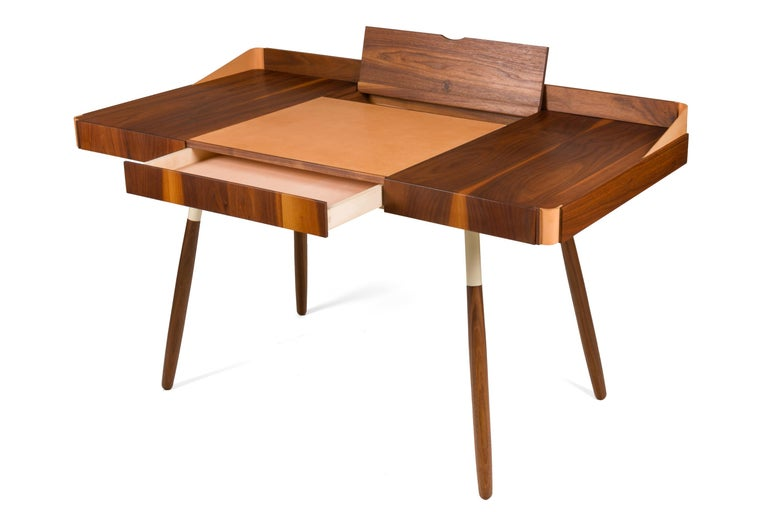 A contemporary design in the Scandinavian tradition by Oluf Lund. Lund studied furniture design at the Aarhus School of Architecture. In his workshop he designs and develops his furniture in small series, He designed furniture for a project at the