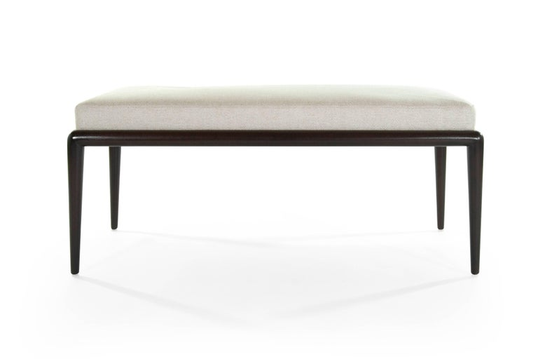 A very clean Minimalist bench designed by T.H. Robsjohn-Gibbings for Widdicomb, circa 1950s.  Walnut frame fully restored, newly upholstered in linen featuring a prism design and single off-center button.