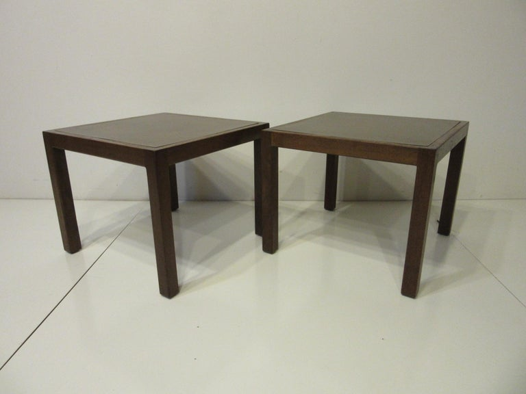 A parsons styled walnut framed set of side tables with veneer acid etched brass and clear coated  inserted tops . Simple and well crafted locally known in the Seattle area as Northwest Contemporary they till retain the original manufactured labels