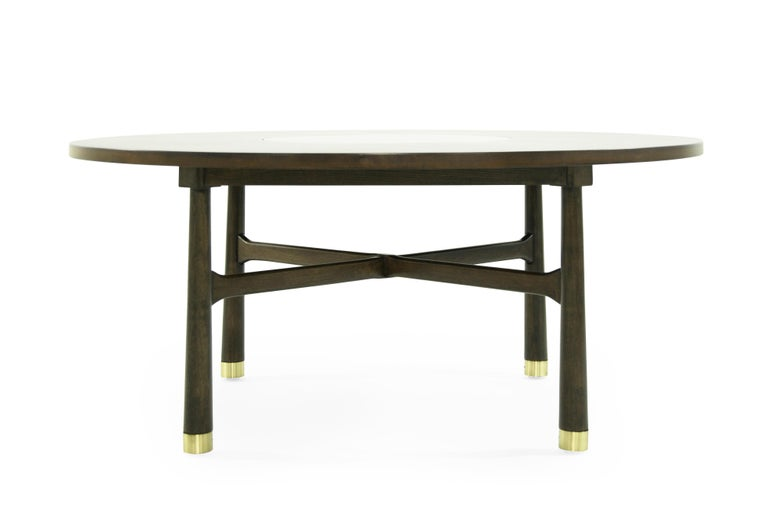 Fully restored walnut cocktail table featuring a newly fitted brass insert, designed by Harvey Probber, circa 1950s.