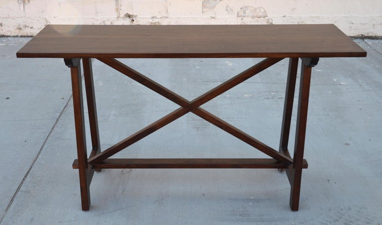 This walnut console table is seen here in 60