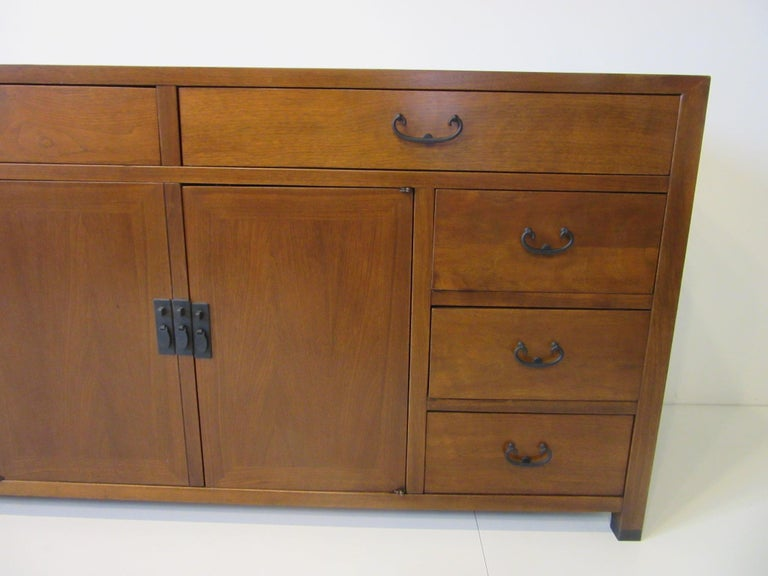 Mid-Century Modern Walnut Credenza / Cabinet by American of Martinsville For Sale
