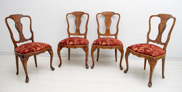 4 Dutch chairs from the mid-20th century. Exceptional quality chairs, richly inlaid in walnut and maple. The upholstery has been redone in worked velvet, partially restored and polished with shellac.