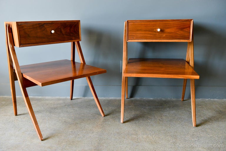 Walnut floating a frame nightstands or side tables by Kipp Stewart for Drexel, 1958. Beautiful original condition with hardly any wear. Original porcelain hardware and pullout / pull-out drawer with floating lower shelf and solid sculpted walnut