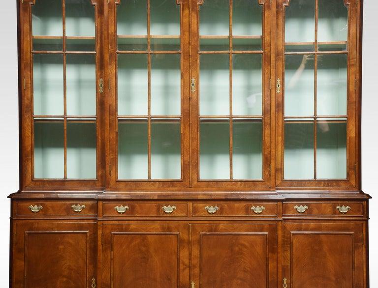 British Walnut Four Door Breakfront Bookcase For Sale
