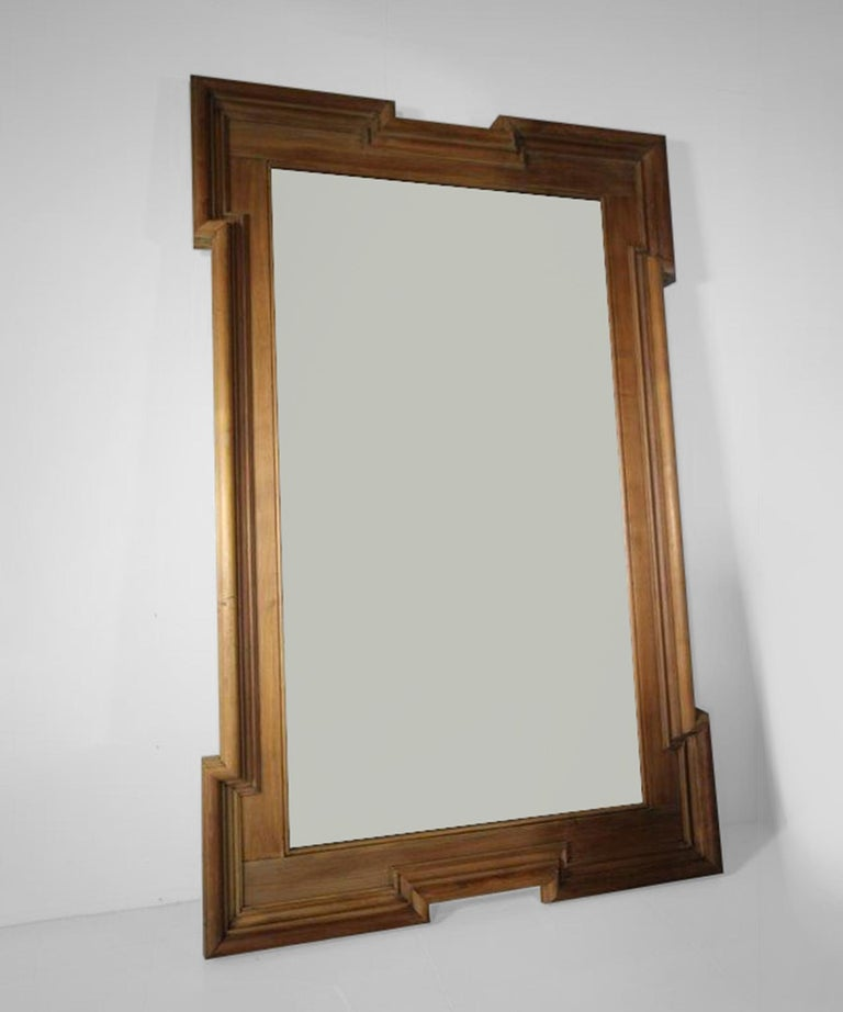 Moulded walnut frame in period finish.