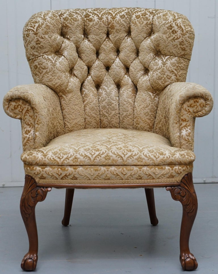 We are delighted to offer this very rare George II style Chesterfield buttoned occasional armchair with ornate hand carved cabriolet legs which start with acanthus leaves and finish with claw and balls.  An exquisite looking and very comfortable