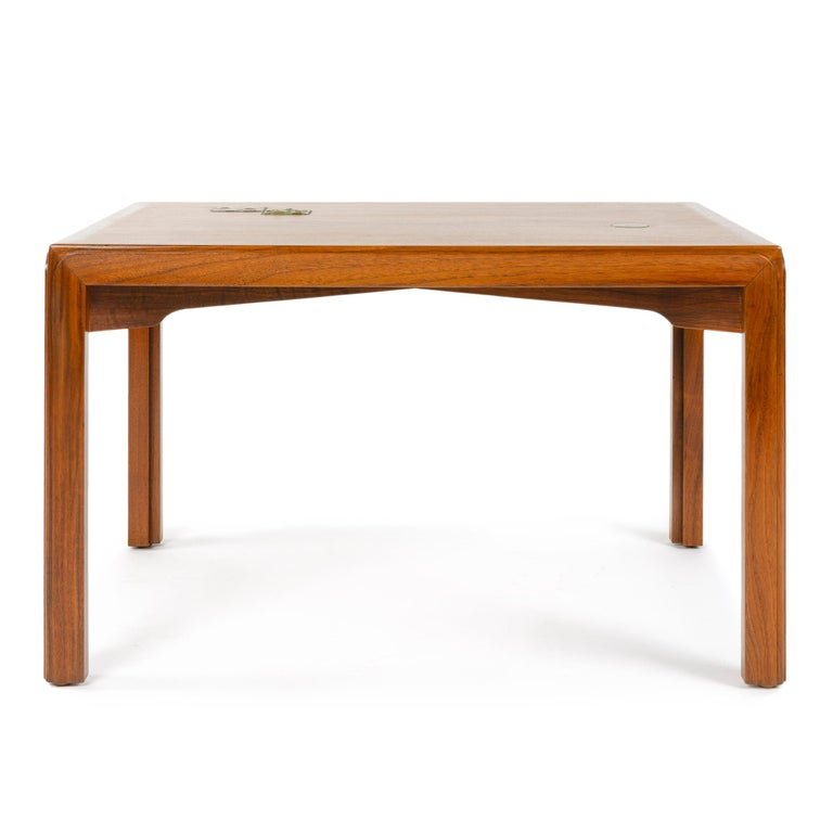 A walnut 'Janus' end table of Asian inspiration, with raised edges to the legs and diagonal cloud-lift stretchers. Accented with green inlaid ceramic tiles.