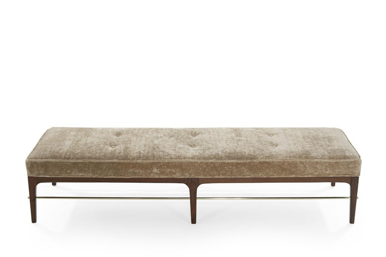 Draw clean lines with contemporary furniture inspired by the Mid-Century Modern Legend, Edward Wormley (1907-1995), a leading American designer.  Echoing the brass bar below, this mohair cushion has lines of crisp welting around the edge.