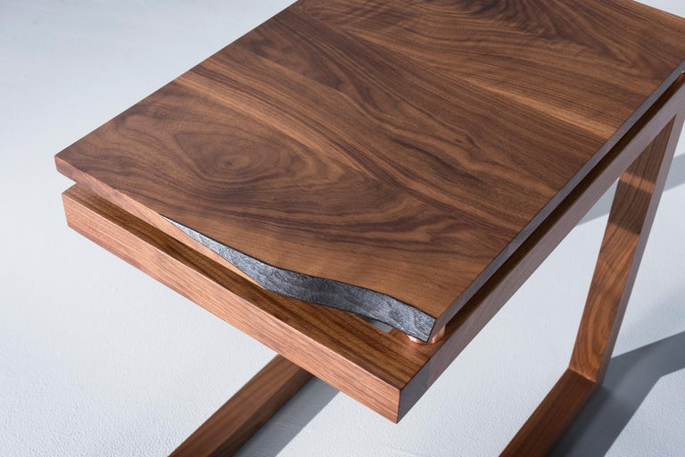 The Clairmount end tables have a walnut live edge board that is elevated using copper tubing to create a modern and organic look. The walnut base is made out of basic joinery to create a sharp modern look to the base of the end table. Pricing is per