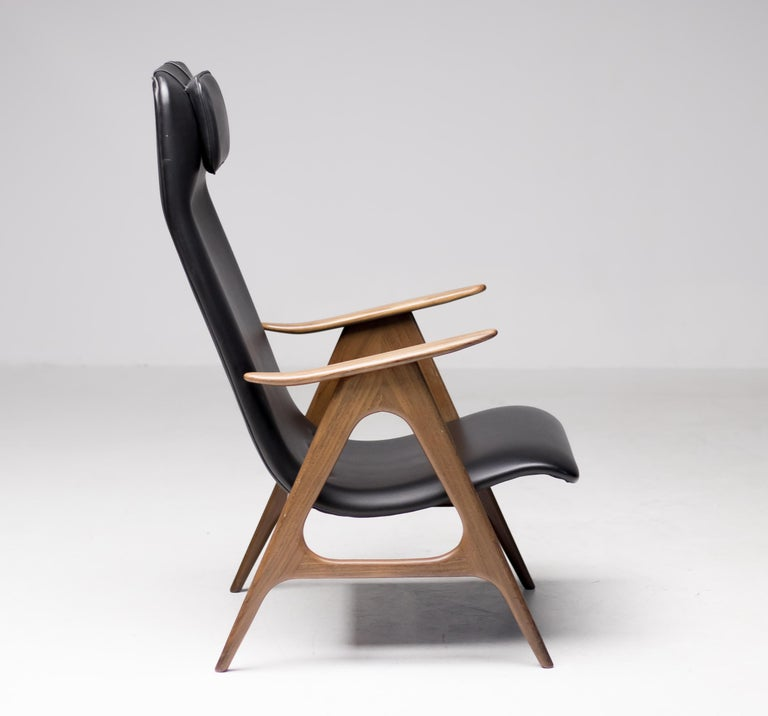All original lounge chair designed by Dutch designer Louis Van Teeffelen. The walnut frame and black Naugahyde upholstery are both in great vintage condition. This chair was lovingly cared for in the past 2 decades by one of the greatest Dutch