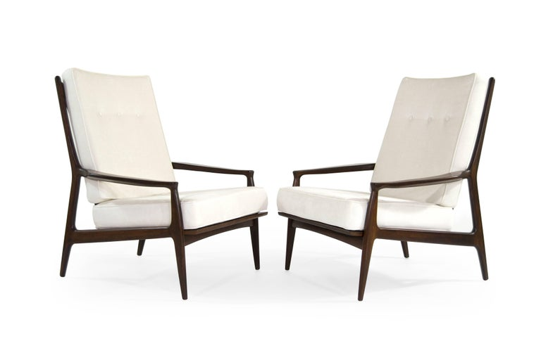 Rare set of high back walnut lounge chairs titled