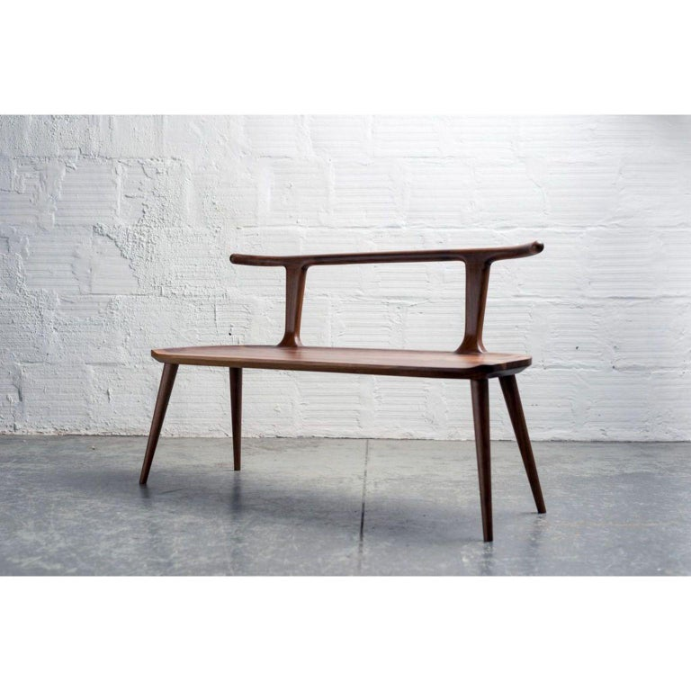 Walnut Oxbend bench by Fernweh Woodworking Dimensions: H 30