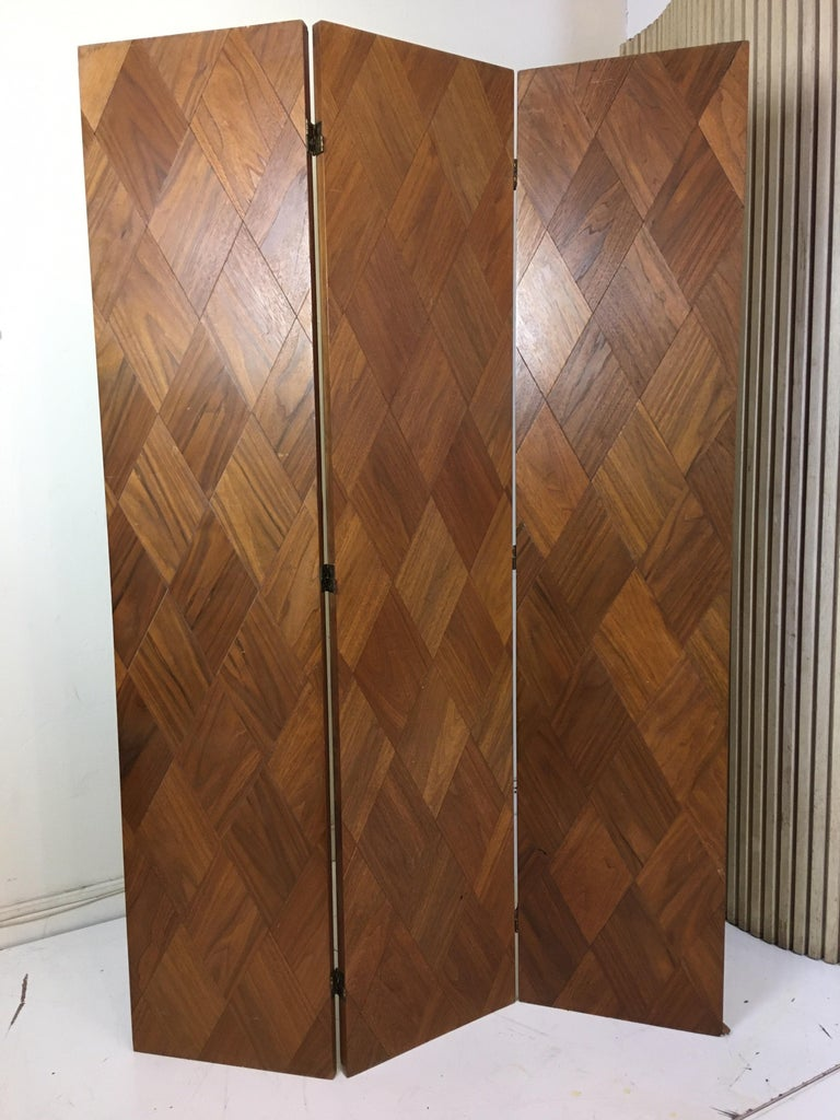 Walnut parquet 3-panel screen, Diamond shaped pieces of walnut cover both sides of all 3 sections. Folds flat for easy transporting. Each panel measures 15.75 wide and screen is just under 72
